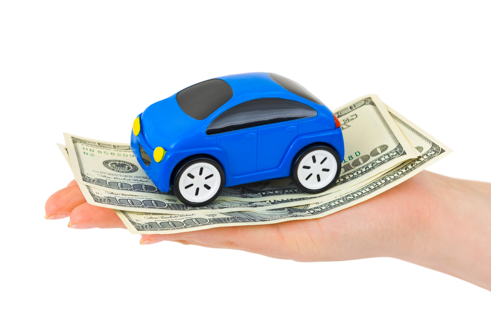 hand holding money and a blue car