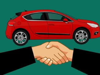 car and people shaking hands